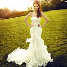 French lace mermaid wedding dress with rolling ruffles. Very airy and romantic.
