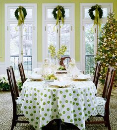 A triple treat of green wreaths with trailing ribbons tops French doors