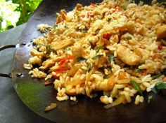 Thai Spicy Basil Chicken Fried Rice from Food.com:   								I had this at a recent potluck and it was wonderful!  Make sure you use Thai Basil as it has a very different taste from Italian Basil.  This recipe is fast and fairly easy to make, but requires constant stirring.""