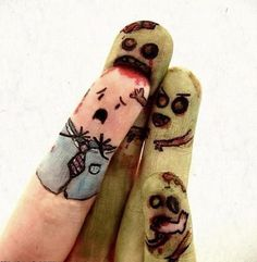 I remember drawing faces on my fingertips when I was a kid; they didn't look like this. This is pretty funny.