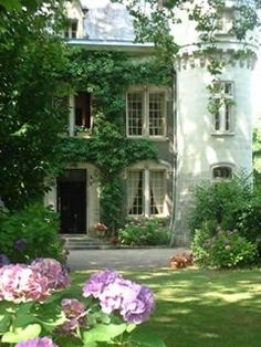 ❥ chateau, France.  Chateauesque style french country stone and plaster cross hatched windows, beautiful