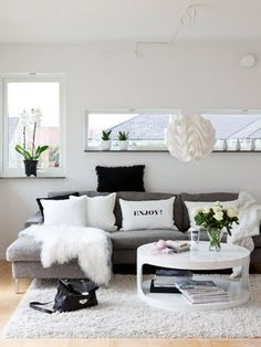 grey couch, white coffee table then color accents to pop.=