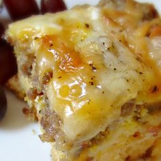 Weekend Biscuit Egg Casserole - 1 can of buttermilk biscuits (8 count),   1 pound of any breakfast sausage roll (browned, drained, and cooled),   1 cup shredded mozzarella cheese,   1 cup of shredded cheddar cheese,   5 eggs, beaten,   2 egg whites,   ¾ cup milk,   ¼ teaspoon salt,   ⅛ teaspoon black pepper