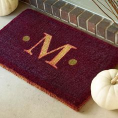 DIY Monogrammed Doormat. Spray paint over letter onto coir mat! via: http://www.bhg.com/halloween/outdoor-decorations/pretty-front-entry-decorating-ideas-for-fall/#page=12