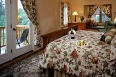 Room 11: Enhanced Traditional Guest Room located on the third floor with a king bed, lake view window seat, outdoor balcony, and a private bathroom with a steam shower & whirlpool tub. $435.00 MAP, $395.00 B&B