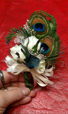 babys breath with  peacock feathers  arrangement   Mother of the Bride Peacock Corsage by SomethingHeavenly on Etsy