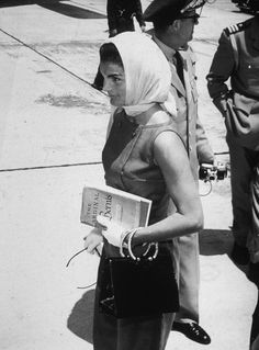 everything-kennedy:    Jacqueline Kennedy walks at an airport, wearing a scarf covering her head, after a visit to the Kennedy estate, Palm Beach, Florida, May 15, 1961.