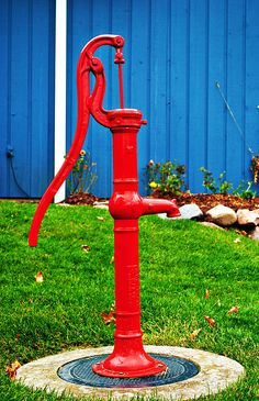old red water pump