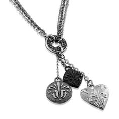 From Edward Mirell's Lace Collection. Featuring Gray and Black Titanium with Sterling Silver.