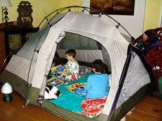 Put up a tent indoors.... The kids will probably love it and will be more likely to go to bed on time...  Put their mattress inside the tent ... How fun!
