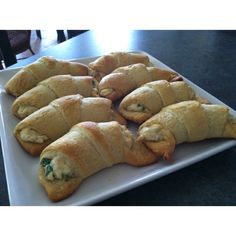 Roasted Garlic Chicken Puffs~ Chicken, fresh garlic, cream cheese, sharp cheddar cheese, swiss cheese, chives, green onions. Stuffed into a crescent roll and baked.