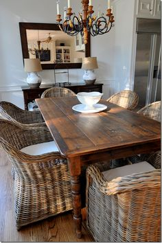 Farmhouse table with wicker chairs