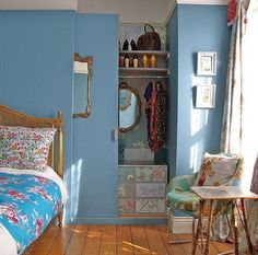 paint a sliding closet door the same color as the wall & hang a mirror on it -- voila! what closet door?