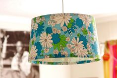 What a funky idea...take a vintage sheet (or in my case a vintage needlecrafted pillowcase) to cover the lamp shade.