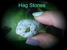 Hag Stones, also known as Witch Stones, Fairy Stones, Holy Stones and Eye Stones, are stones with naturally formed holes running clean through them. These holes are usually formed by centuries of wave action. It is this association with running water (which itself is said to negate the effect of evil) that is believed by many people to be the source of the Hag Stone's reputation for guarding their owner against ill-fortune and the Evil Eye. water, fairies, cleanses, waves, hag stone, stones, running, evil eye, eyes