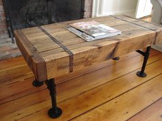 Reclaimed barnwood coffee table vintage/industrial by scottcassin, $295.00  I like the metal straps.