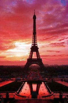 The Eiffel Tower at sunset. www.girlsguidetoparis.com #budgettravel #travel #color #paris #france #eiffeltower #color #red www.budgettravel.com