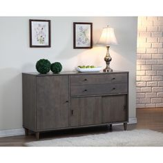Add a stylish touch to your dining room with the Vilas light charcoal grey buffet. Constructed of durable wood, this piece features matte black pulls and two adjustable shelves.