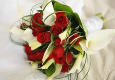 Red roses and white calla lily bouquet.
