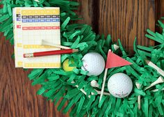 Great centerpiece (even though it was made as a wreath). I would run it down the middle of a table at a Golf Tournament Luncheon or a Men's Banquet. For a men's general event, you can do other sports on other tables.