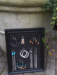 Organize your earrings using window screen and an old frame. Find step-by-step instructions.