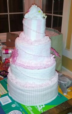 Diaper cake wrapped with receiving blankets.