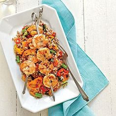 Grain Salad with Grilled Shrimp and Sweet Peppers | If you use wooden skewers, submerge them in water for 30 minutes before threading on the shrimp. | SouthernLiving.com