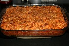 Taco Bake Ingredients: 1 lb. hamburger 1 pkg. taco seasoning 8 oz. sour cream 1 pkg. crescent rolls (8) 1 can tomato sauce 1 can diced tomatoes 1 c. shredded cheese 1. Brown hamburger and drain. 2. Add taco seasoning, tomato sauce, tiny bit of water, and diced tomatoes. Simmer.. 3. In 9x13 dish, press out crescent rolls and roll them to form crust. 4. Layer hamburger mixture, sour cream and then cheese. 5. Crush about 3/4 of a bag of Doritos and put them on top. Bake at 350 for 30 min.
