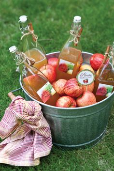 Sweet party favor: Fill glass containers with your favorite apple cider. Tie a cinnamon stick to each bottle with a strand of jute, and add the free favor tag.