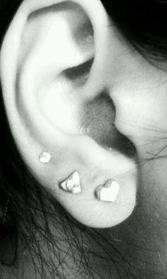 Three ear piercings