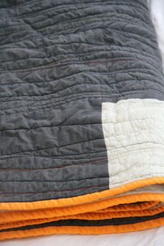 Easy Quilt.  Just take two (or one) solid color fabric and sew zig zag lines.