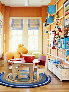 Storage in a play area is a must, and a grid wall unit is a simple way to keep things off the floor but in plain sight. Here, colorful soft-sided bins are secured to the wall between the grid's crossbars, providing instant storage for toys and books. Matching bins below handle the toy overflow.