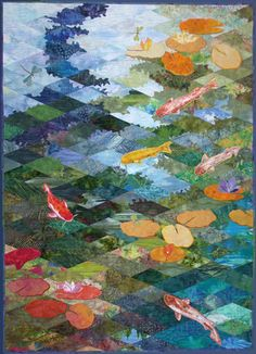 Inspired by the pond in the back garden. created using techniques developed by Jan Krentz, in her book Diamond Landscapes and Beyond. The pieced diamonds create the background, fish and lily pads are appliqued onto the background before quilting.