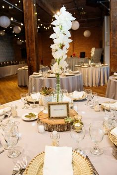 a lovely neutral wedding tablescape.Like the gold chargers with the napkin wrap.