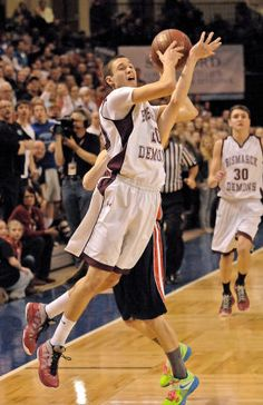 Bismarck's Taylor Schafer gets fouled by Century's Alex Quist with 0.3 seconds left in the second half Friday night. (Tom Strome/Bismarck Tribune)
