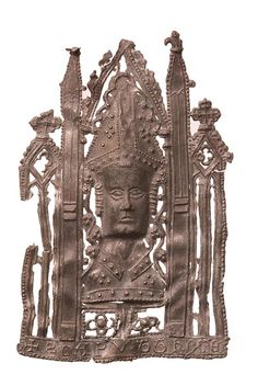 Pilgrim Badge | Museum of London. This badge is a souvenir of the reliquary that held the top of Thomas Becket's skull in Canterbury cathedral. The reliquary was a life-sized bust of St Thomas and was covered in gold, silver and jewels. It was one of the most important holy places to visit during a Canterbury pilgrimage.