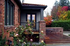 slate blue paint color scheme for exterior house | have a traditional red brick home with white trim. I want to paint ...