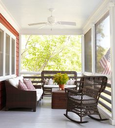 the perfect front porch... fresh flowers, wicker furniture, warm pillows, and the American flag waving! via #bhg #outdoordecor