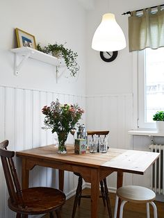 white beadboard, small dining table, white pendant
