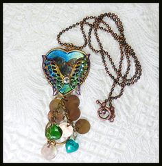#440--$15.00--brass and glass, brass disks treated with heat to patina, brass butterfly and hammered heart, hand-painted.   by Cherie T. Barnes