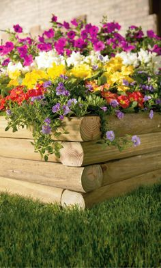 Stack as many landscape timbers as you wish, add flowers, and you've got an instant garden bed (just add water).