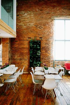 HQ Raleigh > Brick Walls and Wood Floors