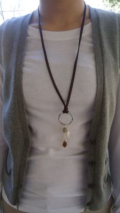 Organic sterling silver circle on leather with pearl and semiprecious stones necklace. $48.99, via Etsy.