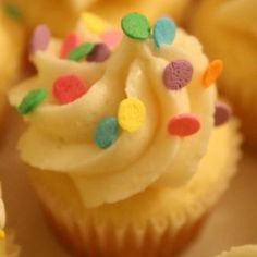 Not all #Easter cupcakes have to be complicated! A cute, simple lemon curd cupcake with Vanilla cream frosting and festive sprinkles is perfect for any celebration.