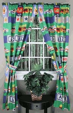 Rescue, by Whisper Soft Mills, from the In Style Home Collection. Adorns bold colored fire trucks & rescue vehicles on a green background. #Kids #Curtains #Swags #Galore