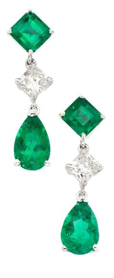 Platinum, Emerald and Diamond Pendant-Earrings.  Topped by 2 square-cut emeralds, joined by 2 square-shaped modified brilliant-cut diamonds approximately 1.05 cts., suspending 2 pear-shaped emeralds, emeralds altogether approximately 4.05 cts. Via Doyle New York.