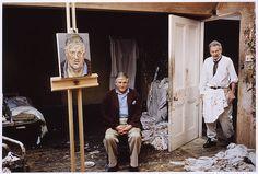 David Hockney seated in Lucian Freud's studio
