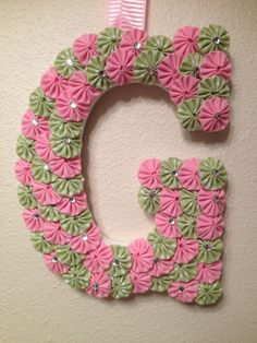 """Custom Wood Letters - Baby Name or Initial Letters - 9"""" Wooden Letter covered with fabric yo-yos can hang on door or wall on Etsy, $22.50"""
