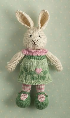 267 different knitted bunnies and other animals!  Adorable designs on all the outfits.