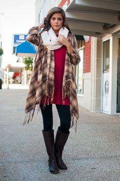 """You don't have to take your time with this cardigan, you can throw it over just about anything! The red and tan plaid is so trendy and we love the loose, flowy fit. Material has no amount of stretch. Miranda is wearing the small. Sizes fit: Small- 0-4; Medium- 6-8; Large- 10-12 Length from shoulder to hem: S- 35""""; M- 36""""; L- 37""""."""